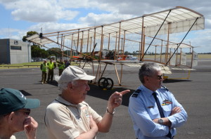 GPCAPT (ret) Ron Gretton AM & WGCDR (ret) Geoff Matthews talk with AVM (ret) Mark Skidmore in front of the Bristol Boxkite replica they built