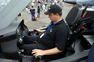 Grant gets to check out the F-35 cockpit. Fortunately it has burners, just like his hot air balloon :)