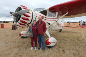 Kevin Bailey and his wife with their Stinson Reliant